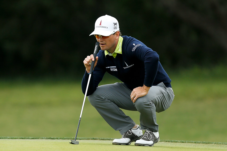 Zach Johnson had an eagle en route to a score of seven-under 65, good enough to tie for the lead with Ryan Moore.