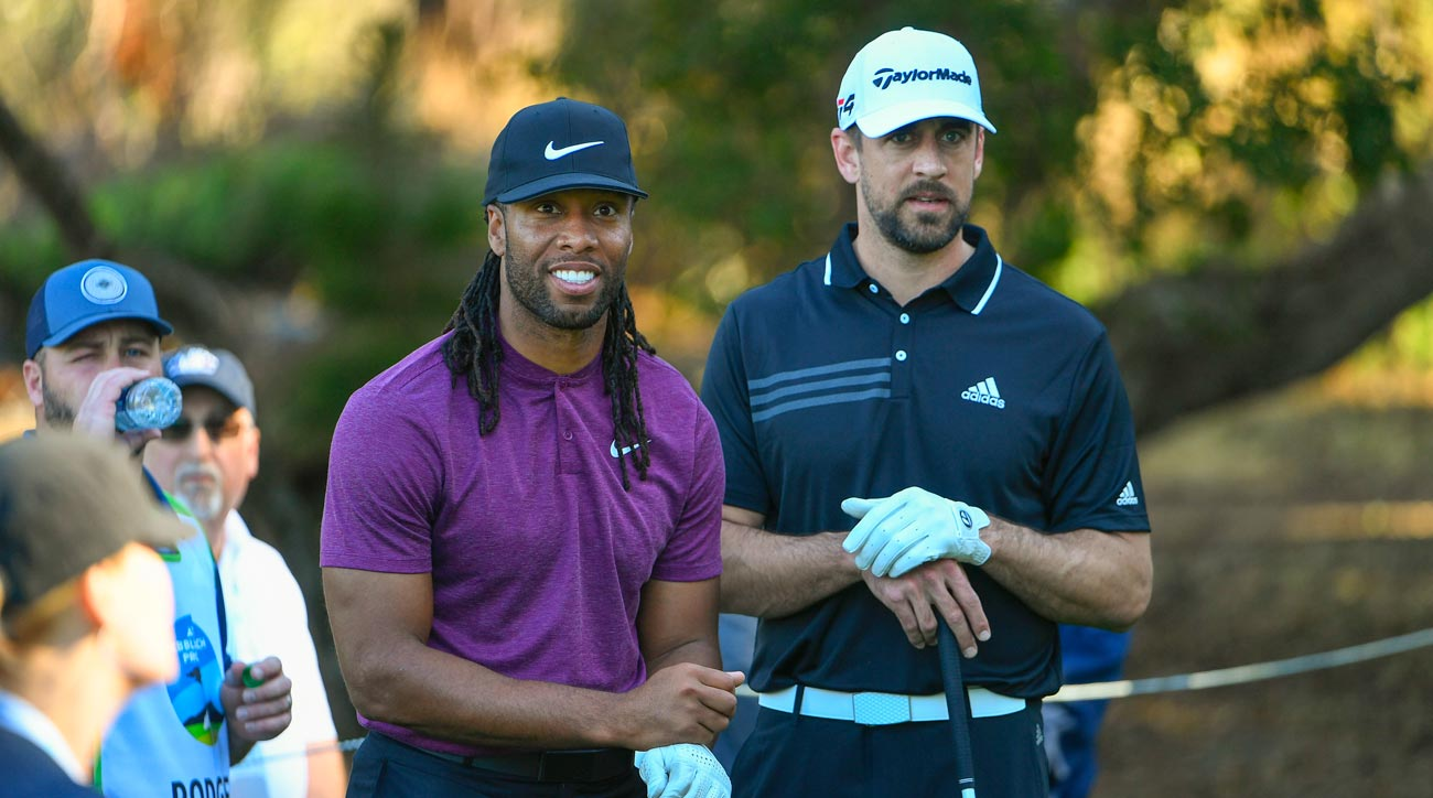 Larry Fitzgerald and Aaron Rodgers play golf at Pebble Beach