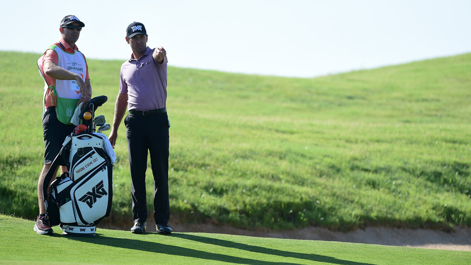 Charles Howell III and his caddie survey the fourth green at Trinity Forest.