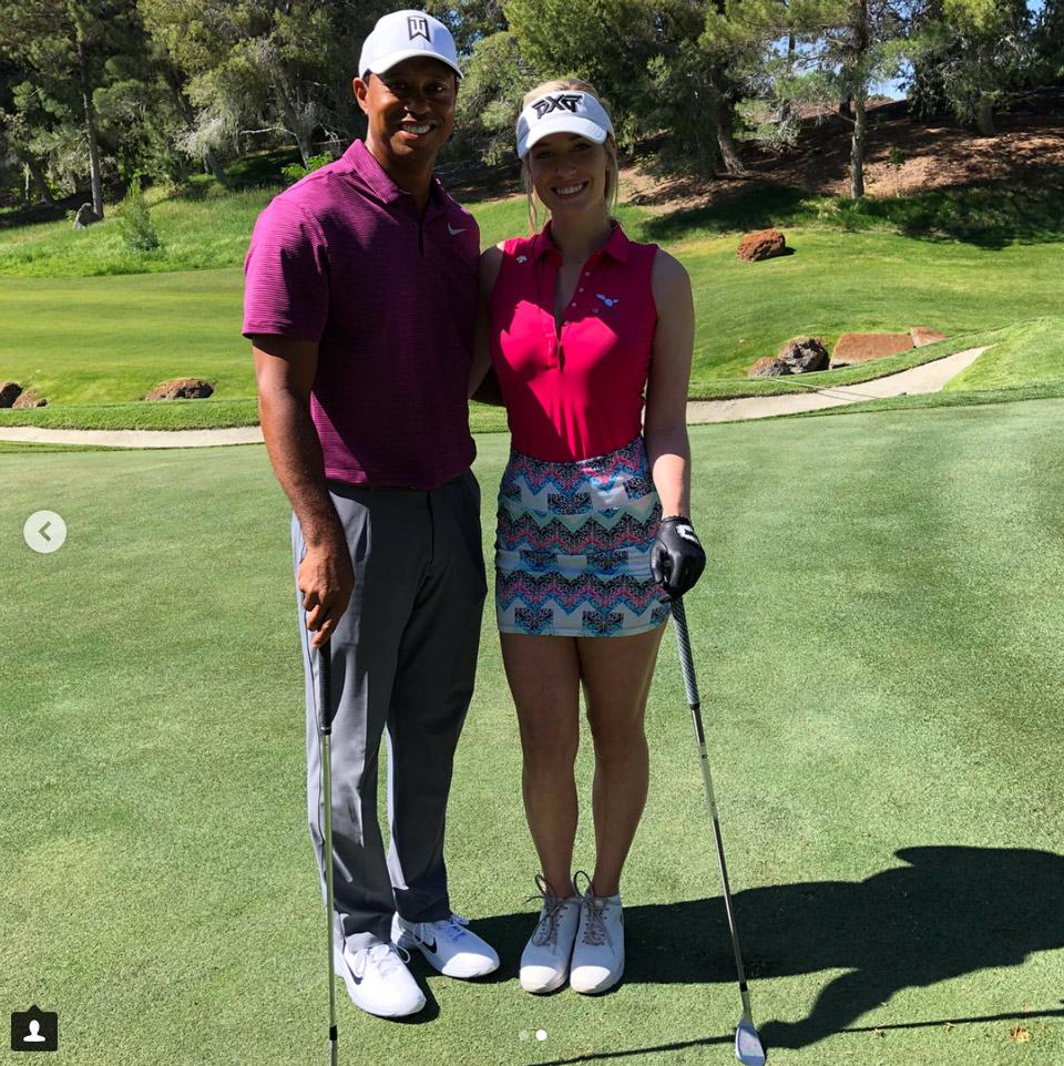 <p>Tiger poses with Instagram sensation Paige Spiranac.</p>