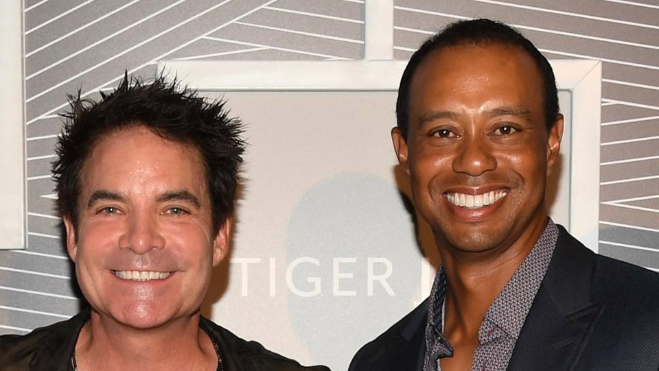 <p>Tiger poses with the lead singer of the band Train, Patrick Monahan.</p>