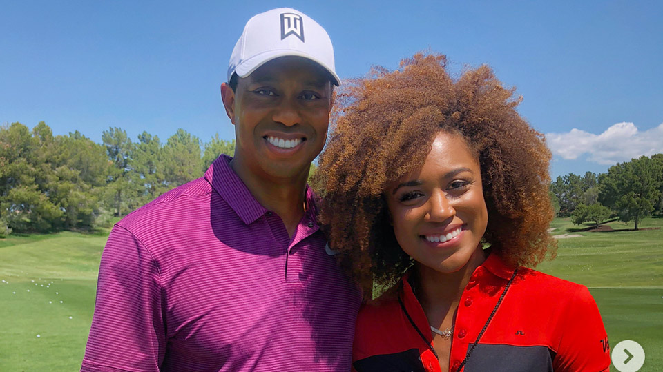 <p>Tiger poses with World Long Driver tour competitor Troy Mullins.</p>