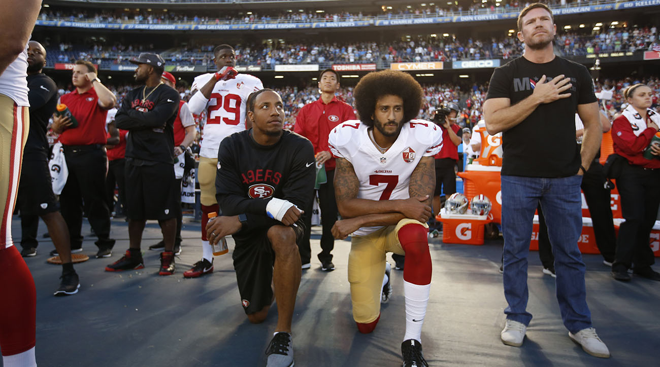 Why do NFL players kneel during the national anthem