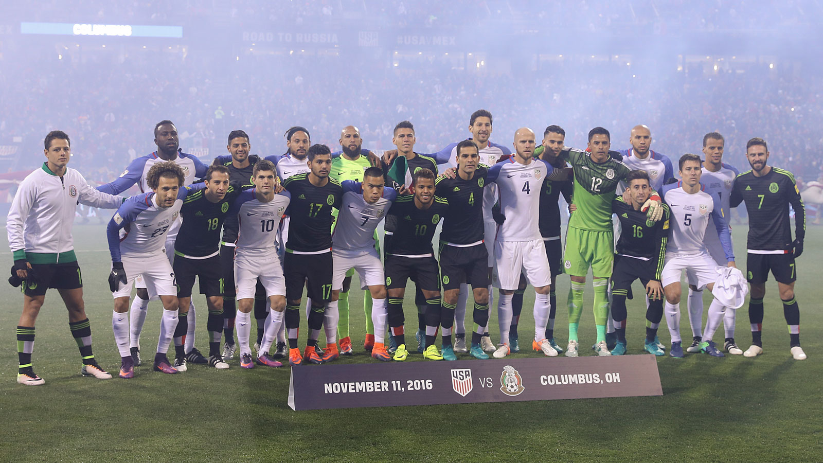 Mexico and USA players link arms at a 2018 World Cup qualifying match