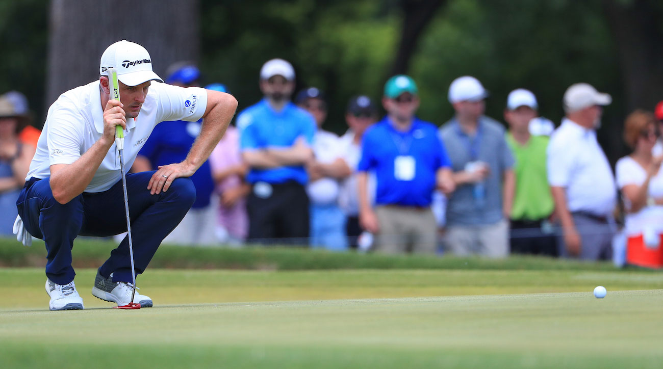 Justin Rose looks over a putt on the second green during the final round of the Fort Worth Invitational in Fort Worth, Texas.