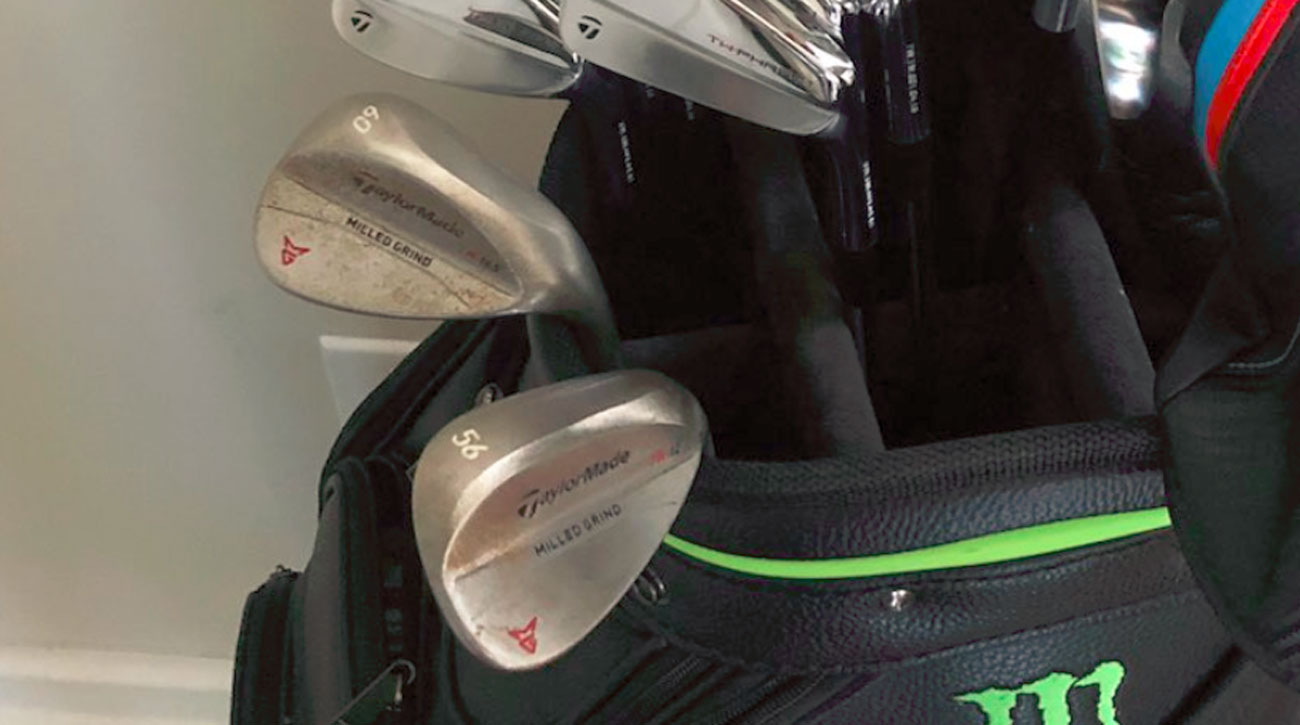 Tiger Woods and his new TaylorMade wedges prior to thee Memorial