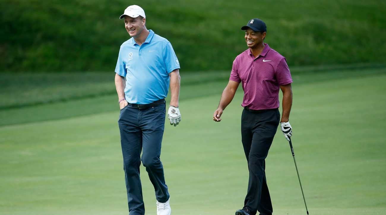 Tiger Woods and Peyton Manning walked the fairways together at Wednesday's Memorial Tournament pro-am.