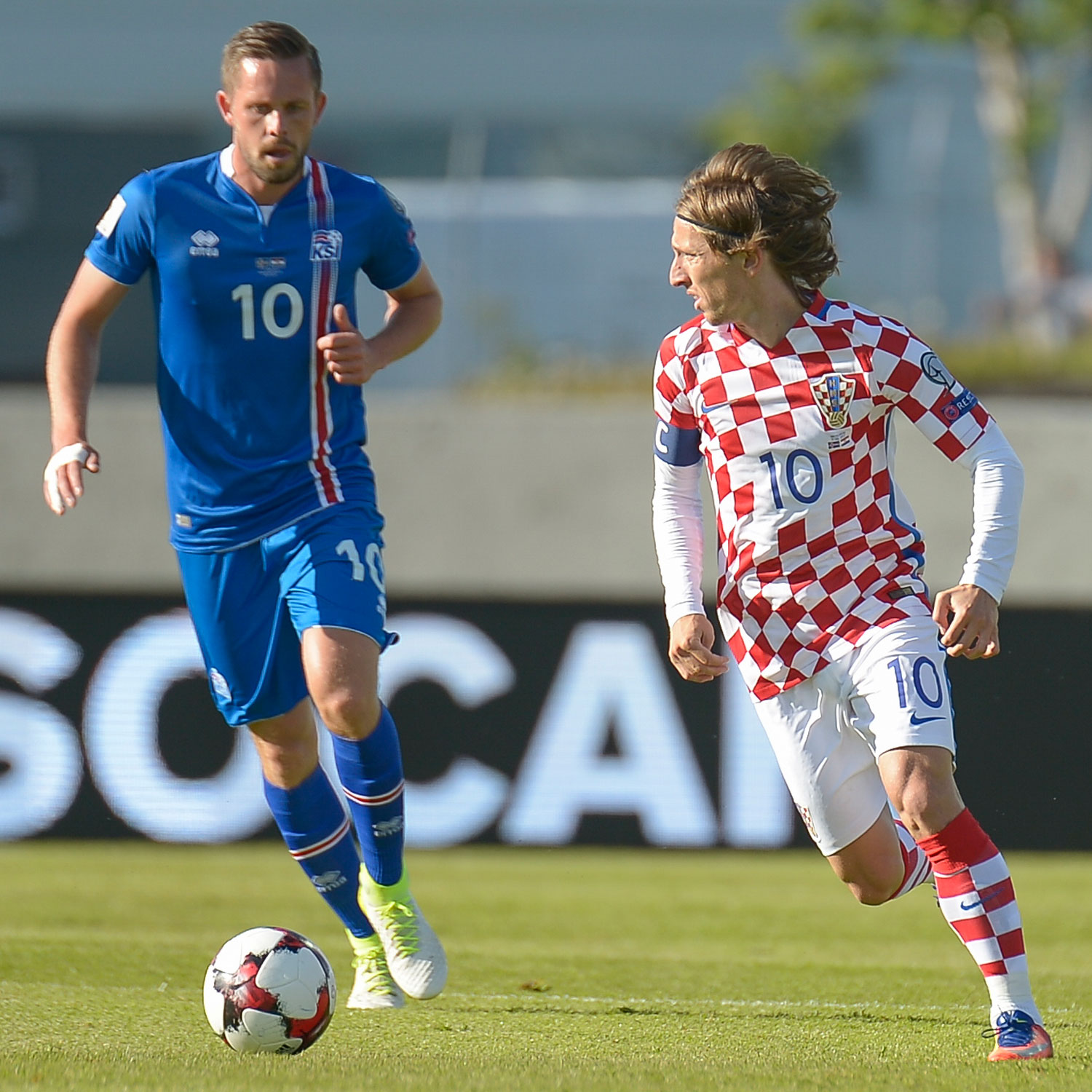 Gylfi Sigurdsson and Luka Modric battle in World Cup qualifying between Croatia and Iceland