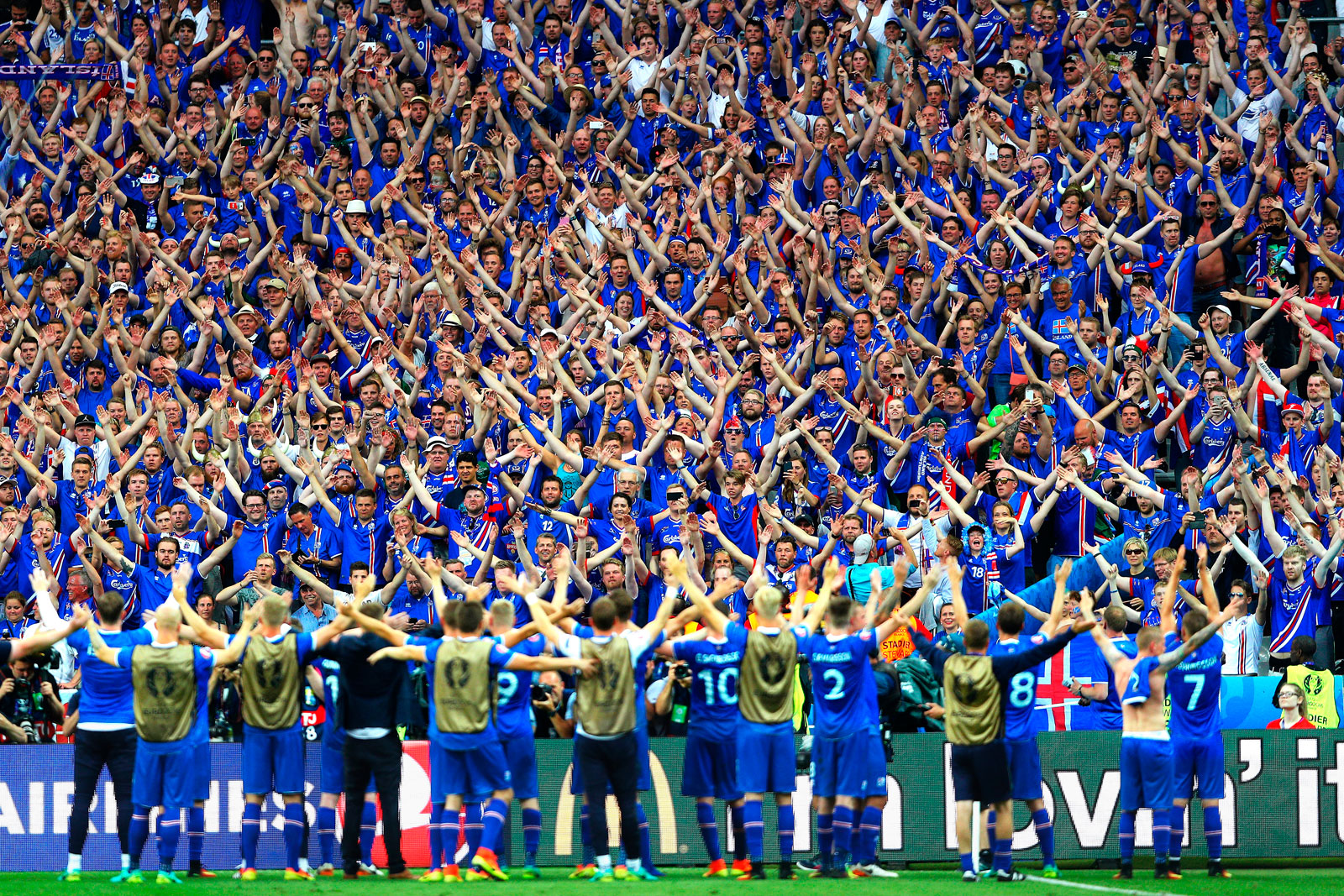 Iceland fans and players perform their viking clap at Euro 2016