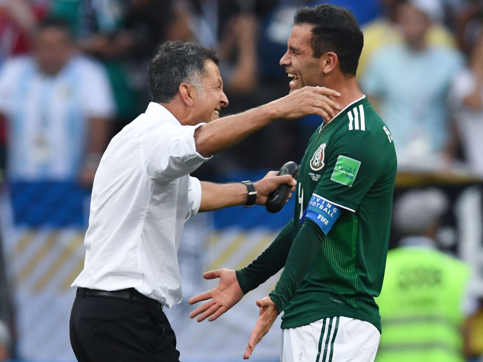 Juan Carlos Osorio and Rafa Marquez embrace after Mexico's win over Germany at the World Cup