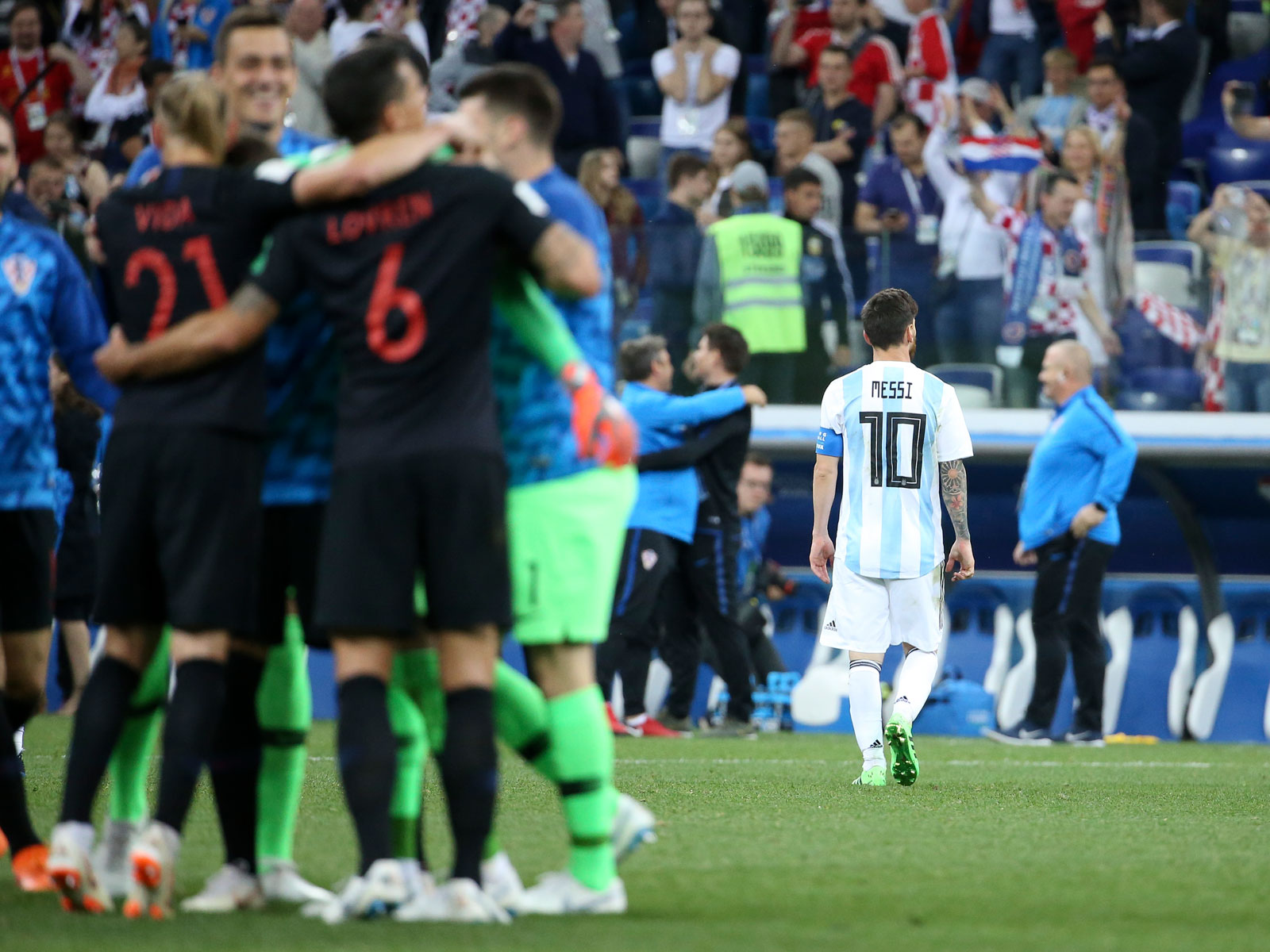 Lionel Messi leaves the field as Croatia celebrates a 3-0 win over Argentina at the 2018 World Cup