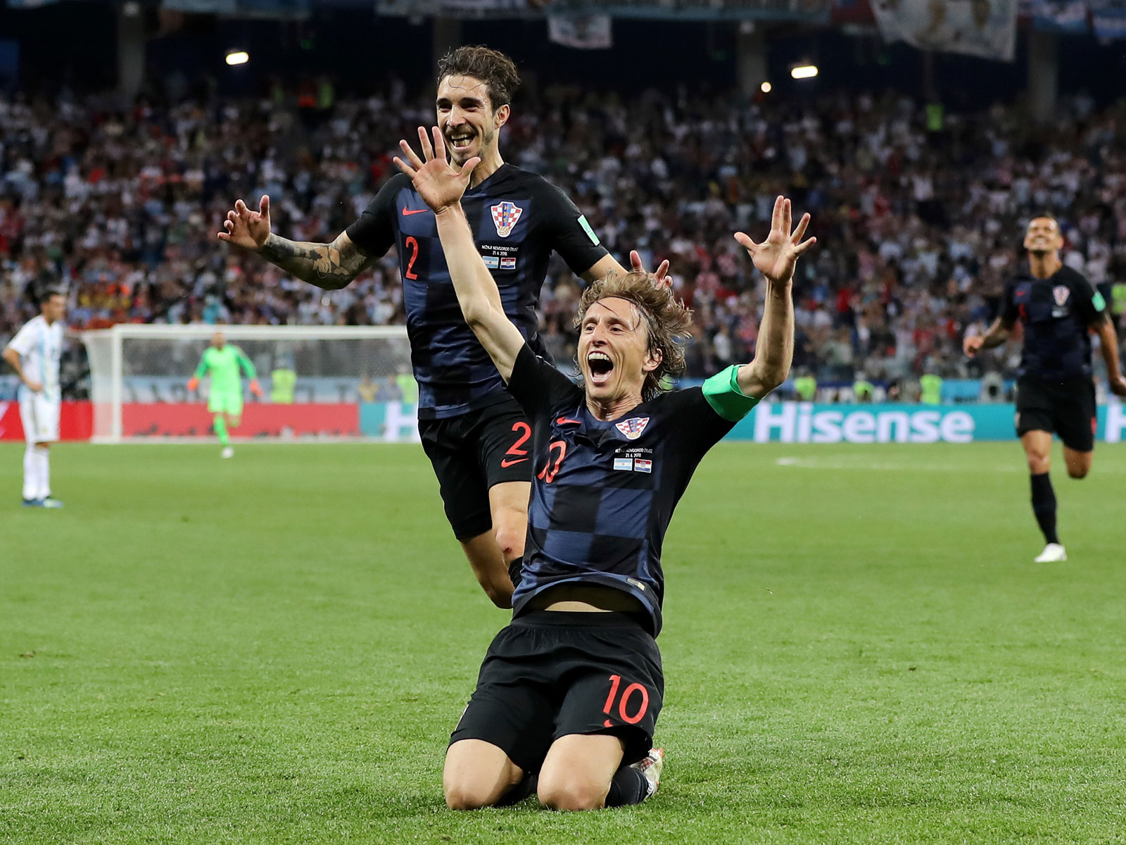 Luka Modric slides in celebration after a goal in Croatia's win over Argentina at the World Cup