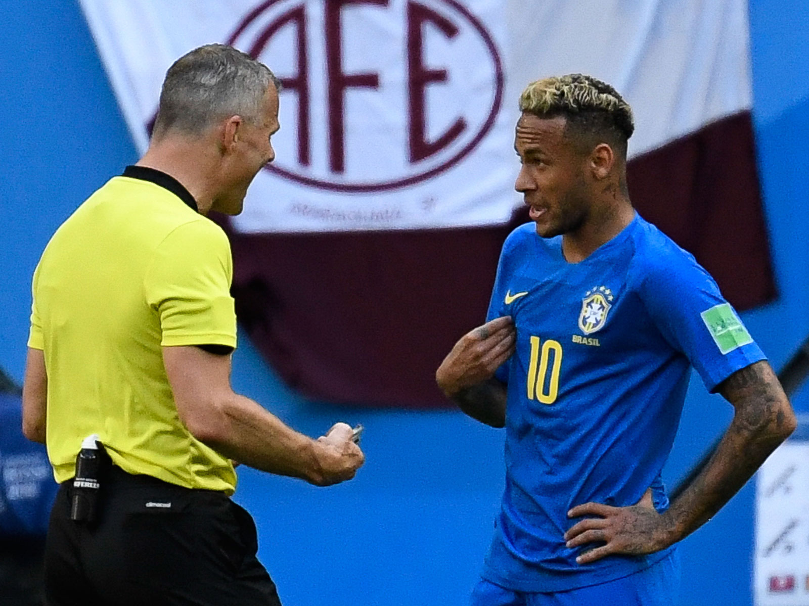 Neymar speaks to the referee in Brazil's match vs. Costa Rica
