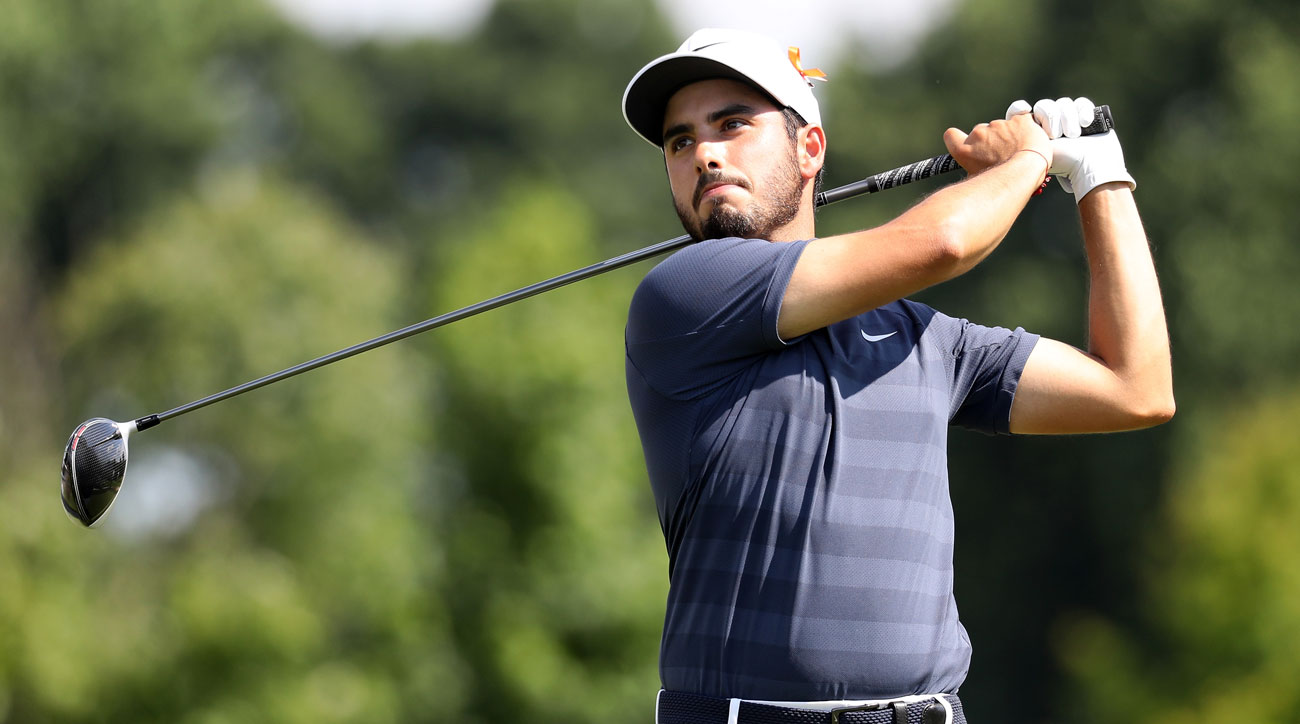 abraham ancer  francesco molinari share lead at quicken