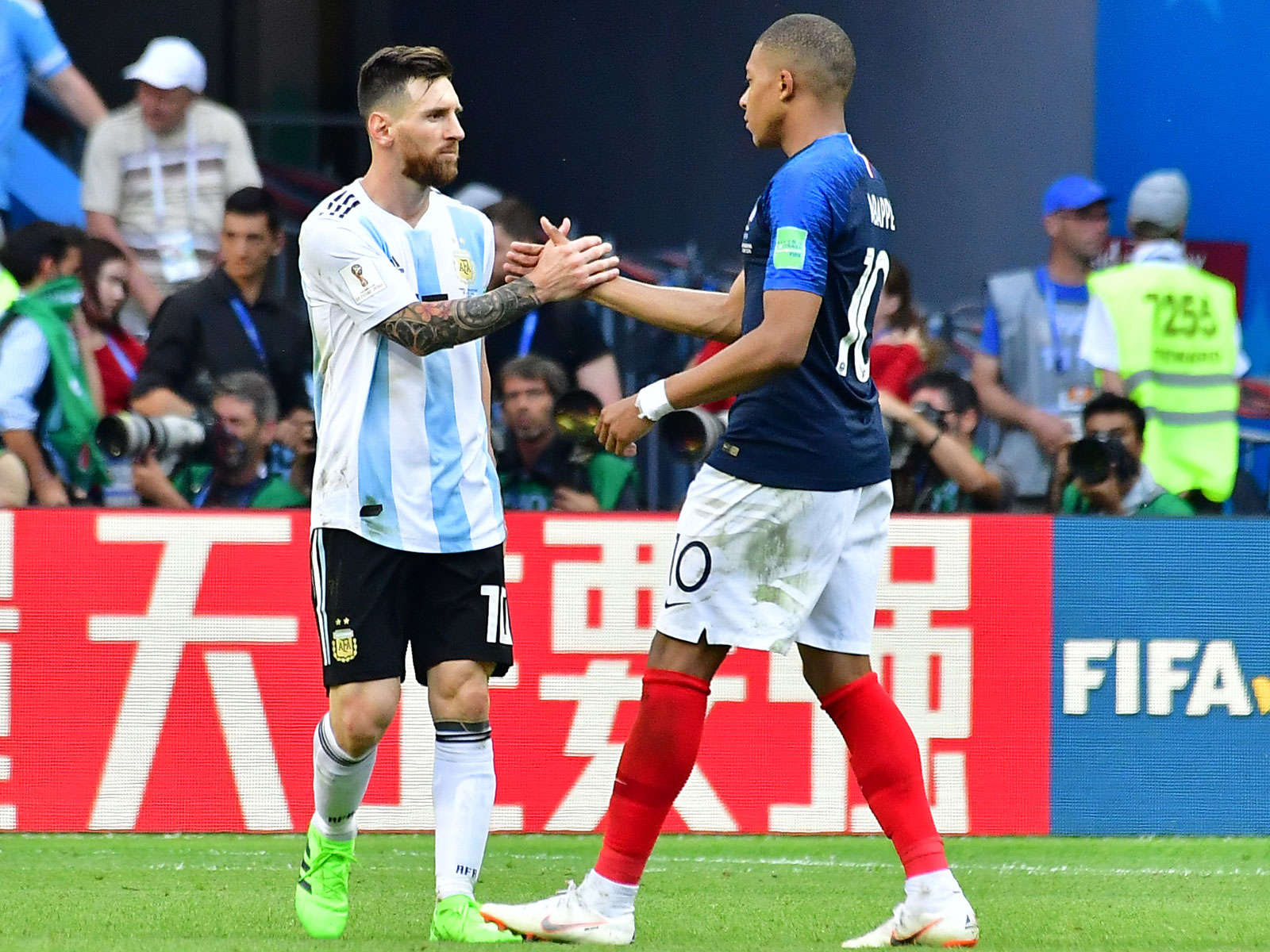 Kylian Mbappe and Lionel Messi greet each other in France's World Cup victory over Argentina