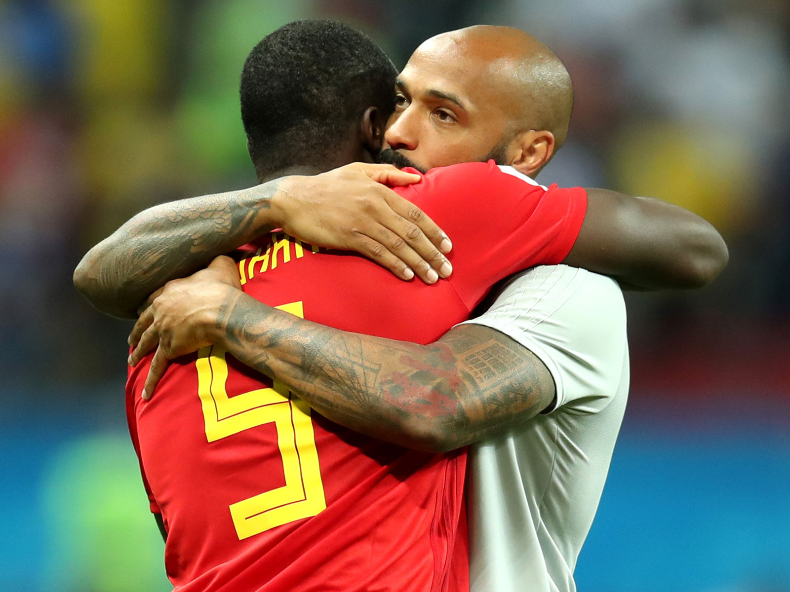 Thierry Henry hugs Romelu Lukaku after Belgium's World Cup quarterfinal win
