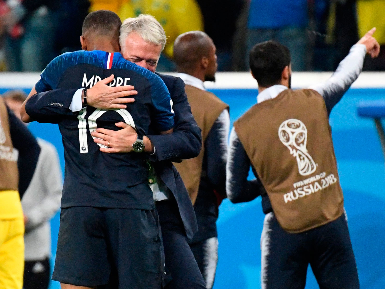 Kylian Mbappe and Didier Deschamps hug after France's win over Belgium in the World Cup semifinals