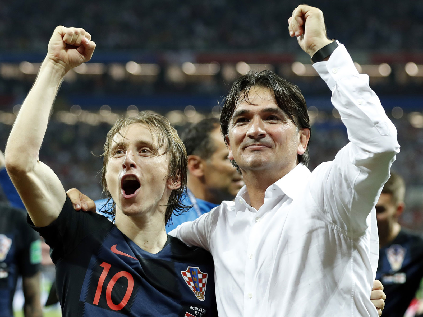Croatia's Luka Modric and Zlatko Dalic celebrate the nation's first World Cup final berth