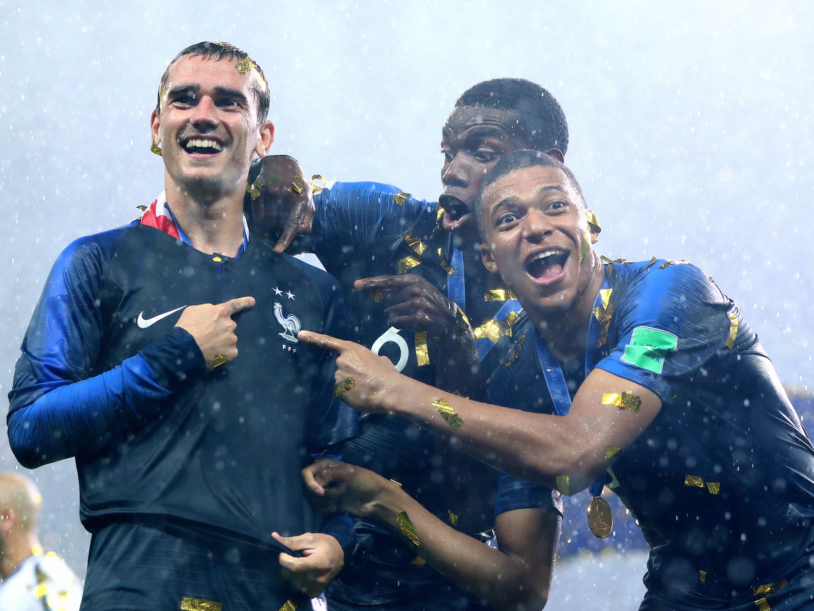 Antoine Griezmann, Paul Pogba and Kylian Mbappe celebrate their World Cup title with France