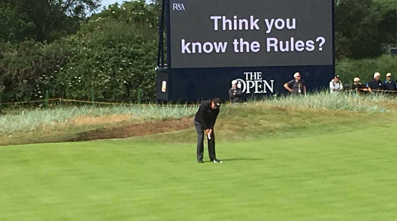 phil mickelson ironically putts in front of rules sign at