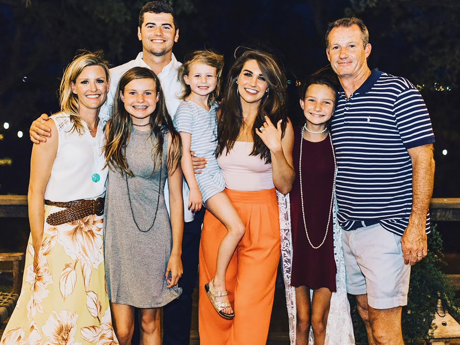 Stidham with his fiancée Kennedy Brown (in orange pants) and the Copelands (from left: Katy, Kalen, Larsen, Marin and Matt).