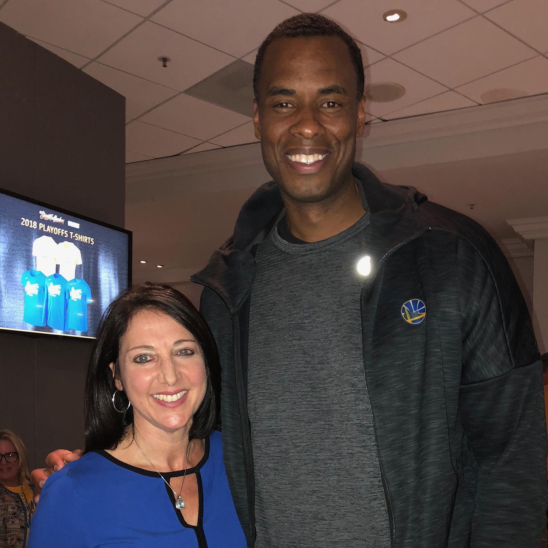 Debbie Spander with client and Warriors assistant coach Jarron Collins.