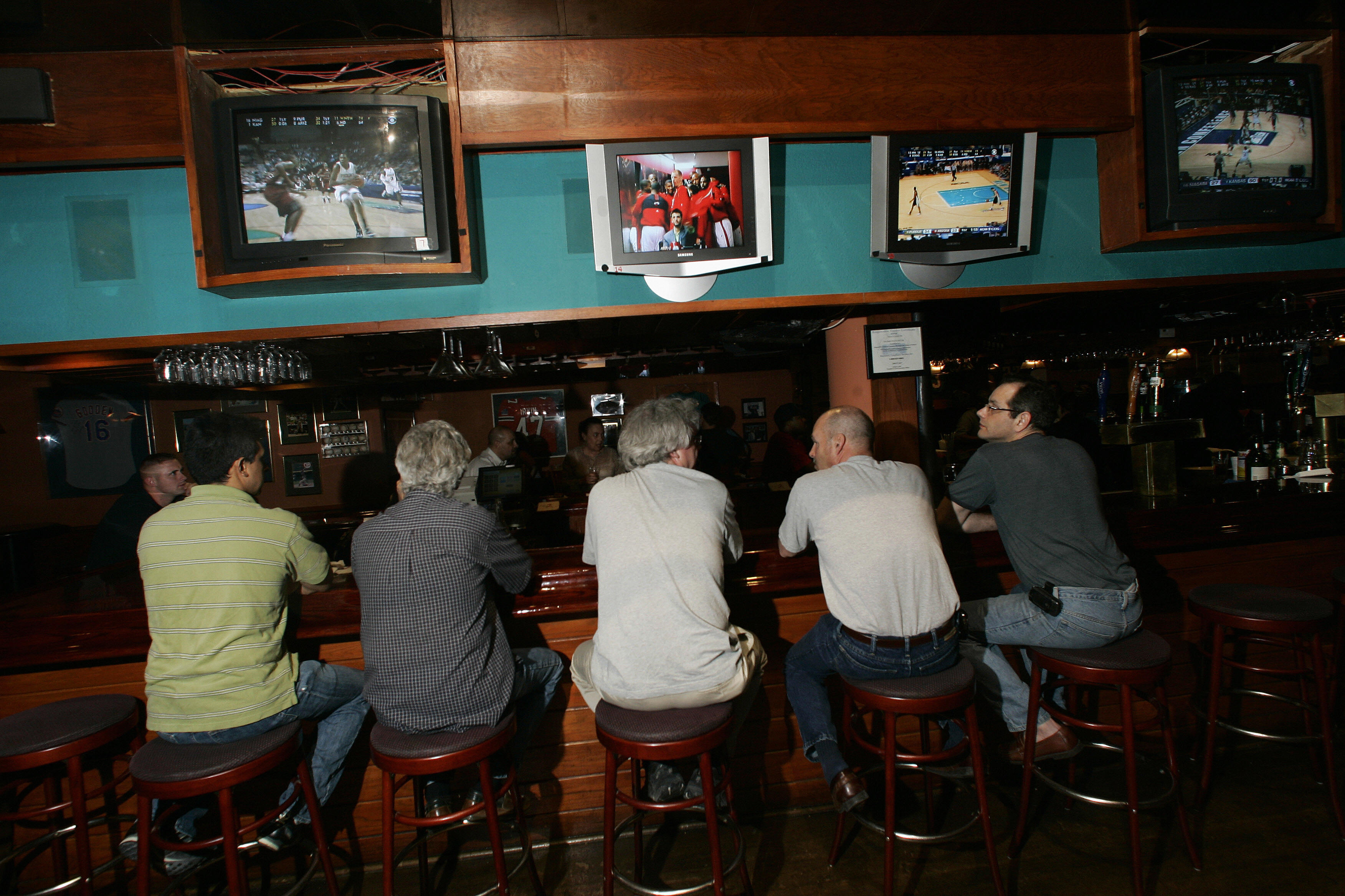 Patrons at Shula's sports bar watch tele