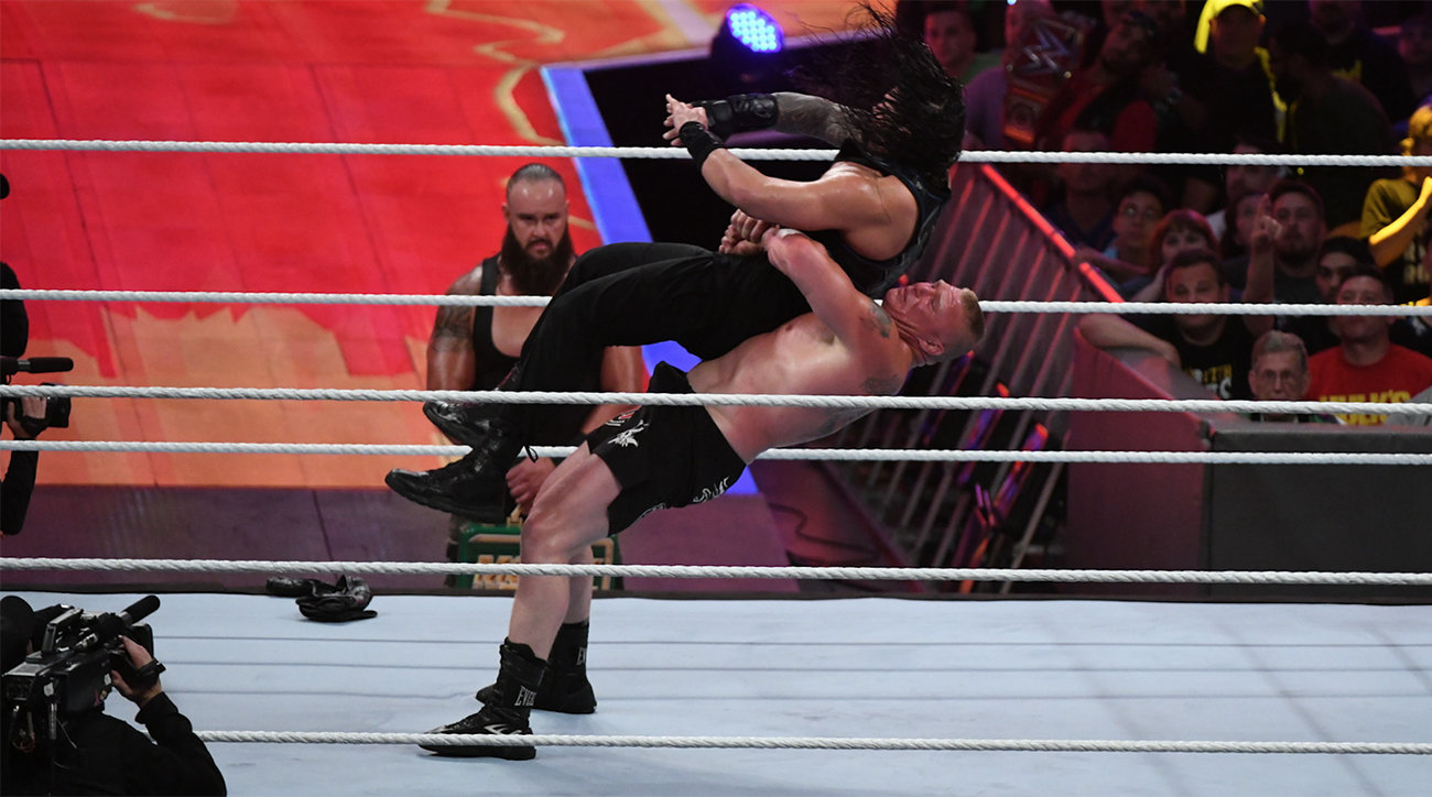 Brock Lesnar taking down Roman Reigns at WWE SummerSlam