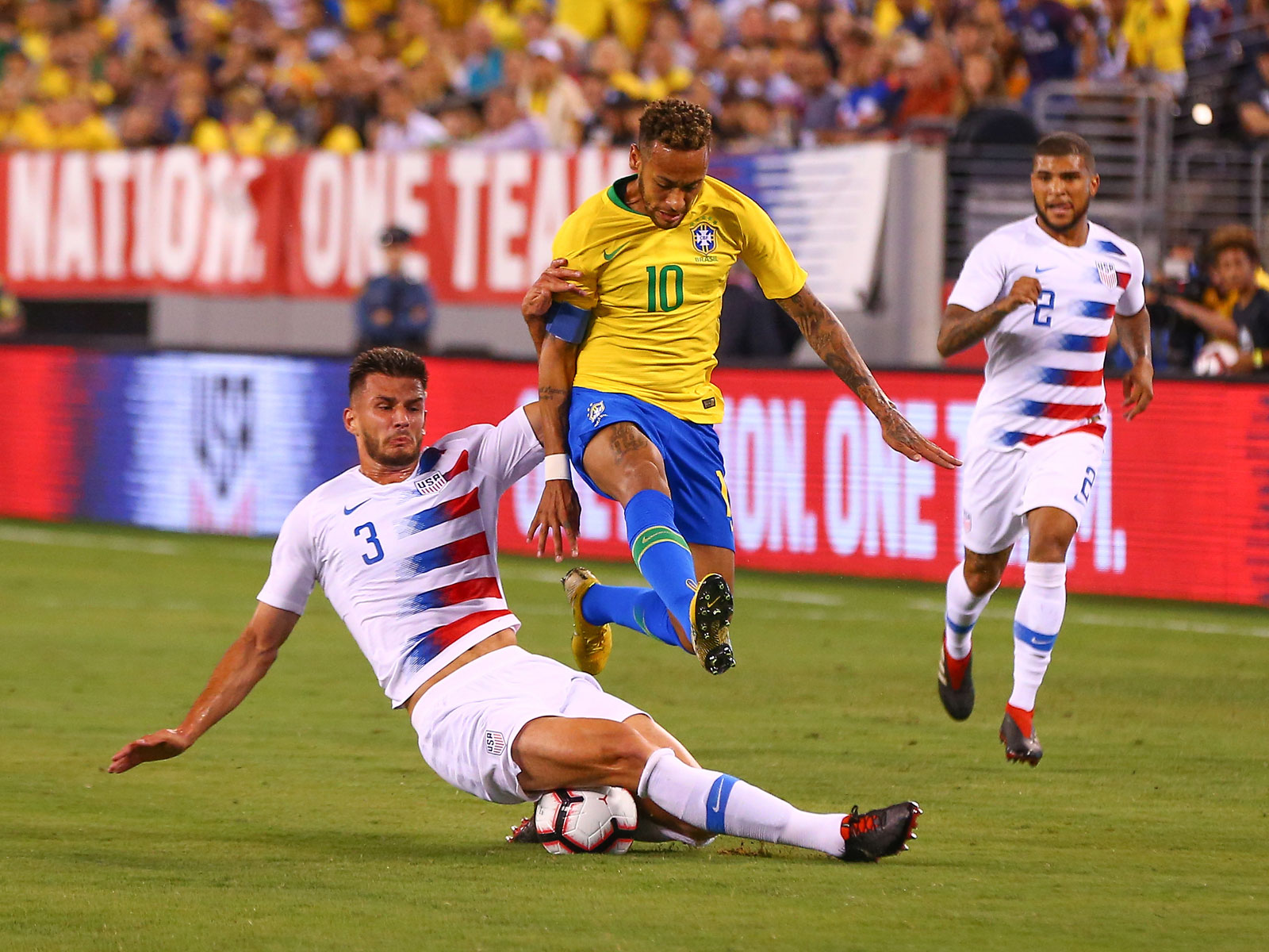 Matt Miazga and DeAndre Yedlin defend Neymar in the USA's loss to Brazil