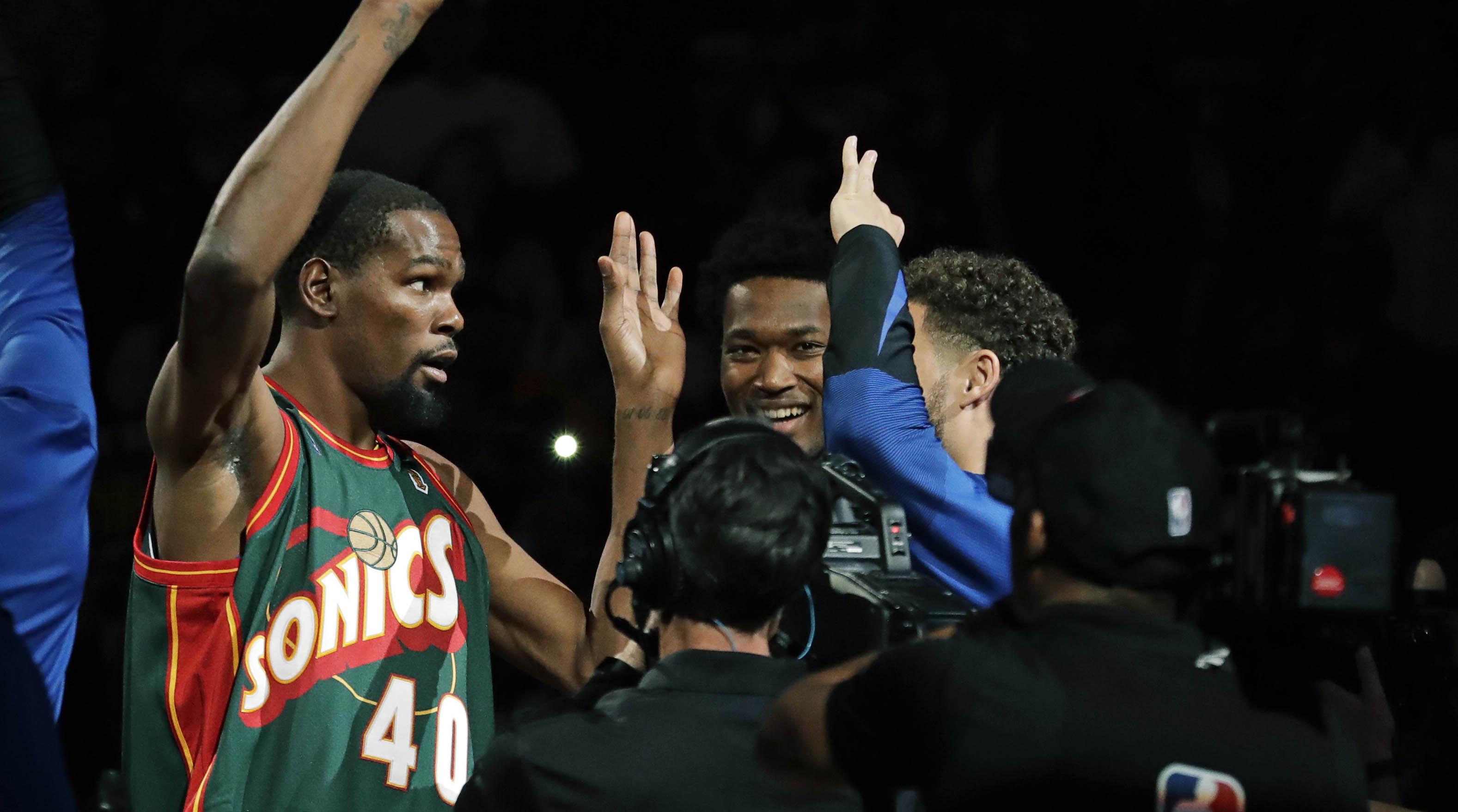 Watch  Kevin Durant wears Sonics jersey in return to Seattle  8d913268b