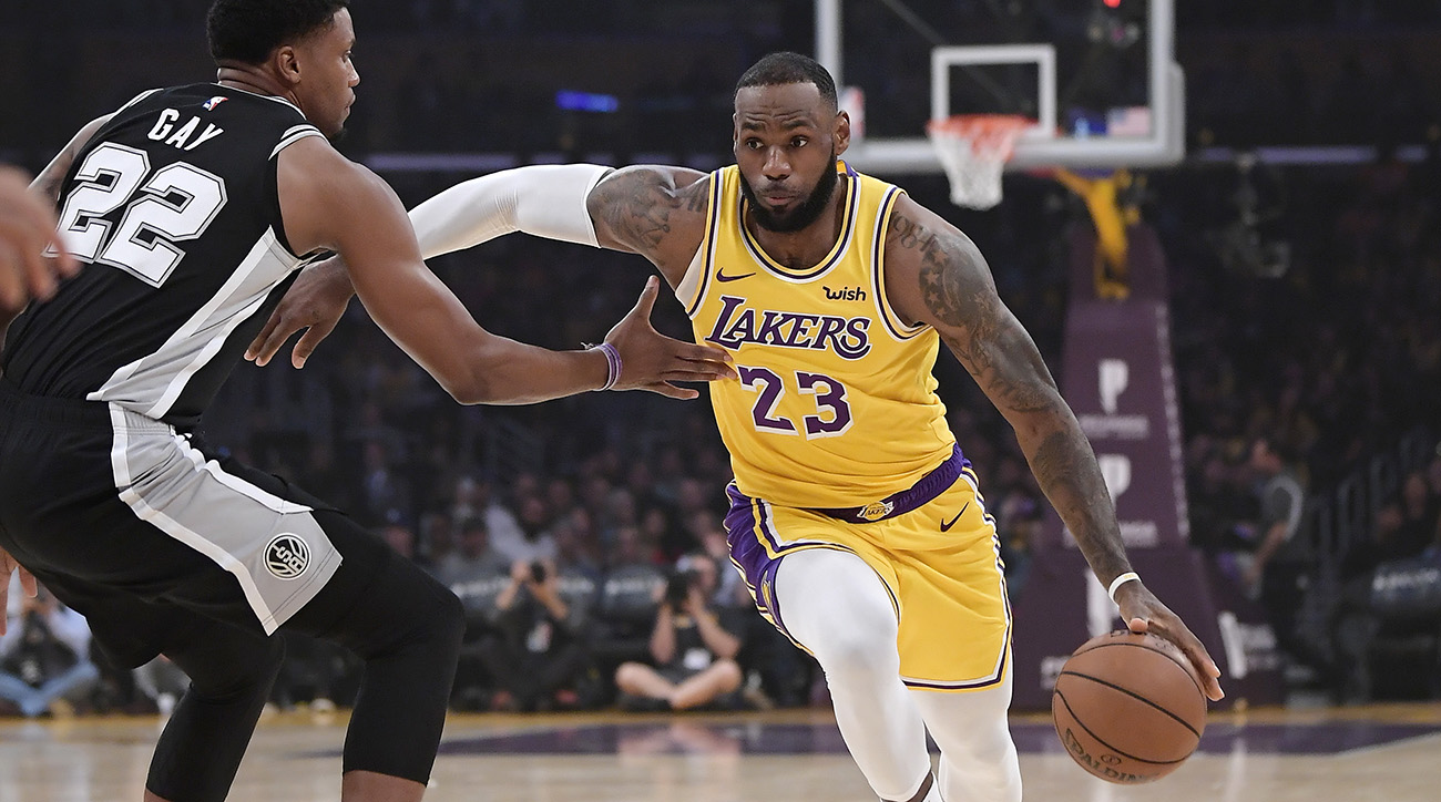 James finally gets into win as Lakers rout Suns
