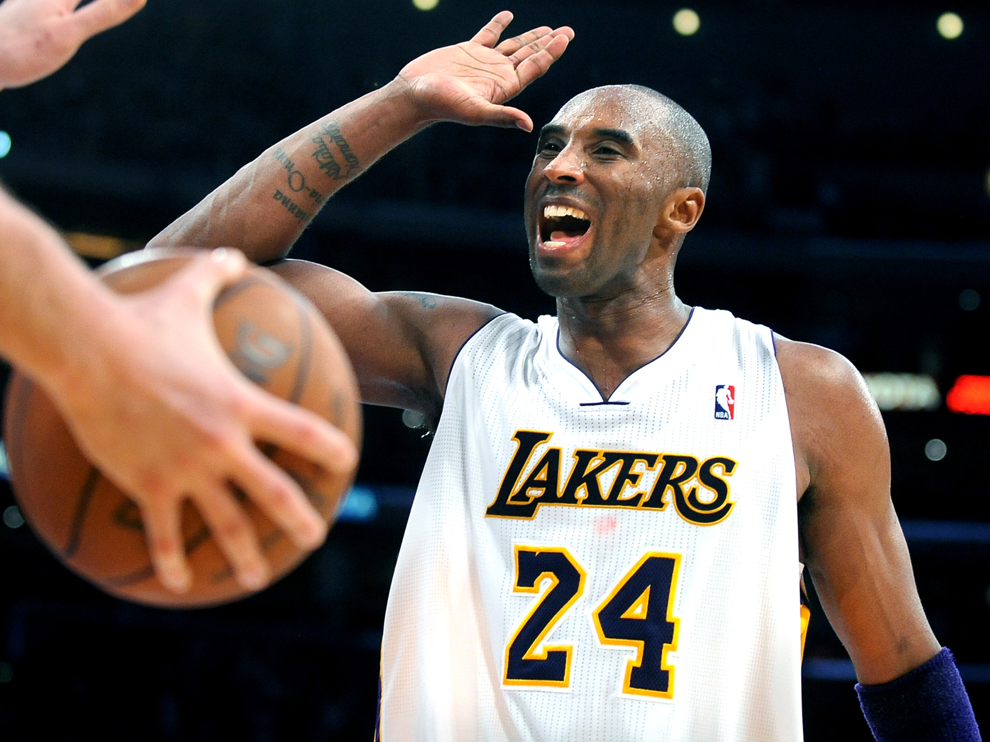 Lakers Kobe Bryant celebrates with teamate Pau Gasol while defeating the Thunder in overtime at the