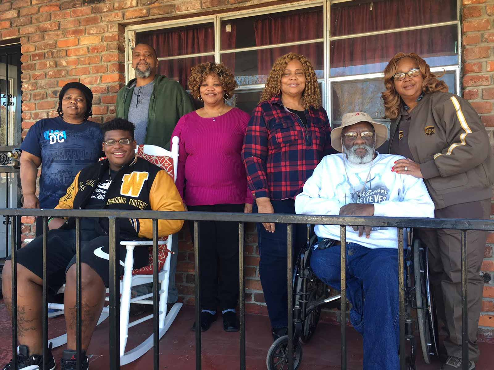 Part of Quinnen Williams's support team is pictured here in a photo taken Wednesday outside of his grandmother's home in Birmingham. From left to right: aunt LaQuita Comack, brother Giovanni Williams, uncle Charles Henderson II, aunt Ivy Allen, grandpa Charles Henderson, grandmother Yvarta Henderson and aunt Marilyn Jackson.
