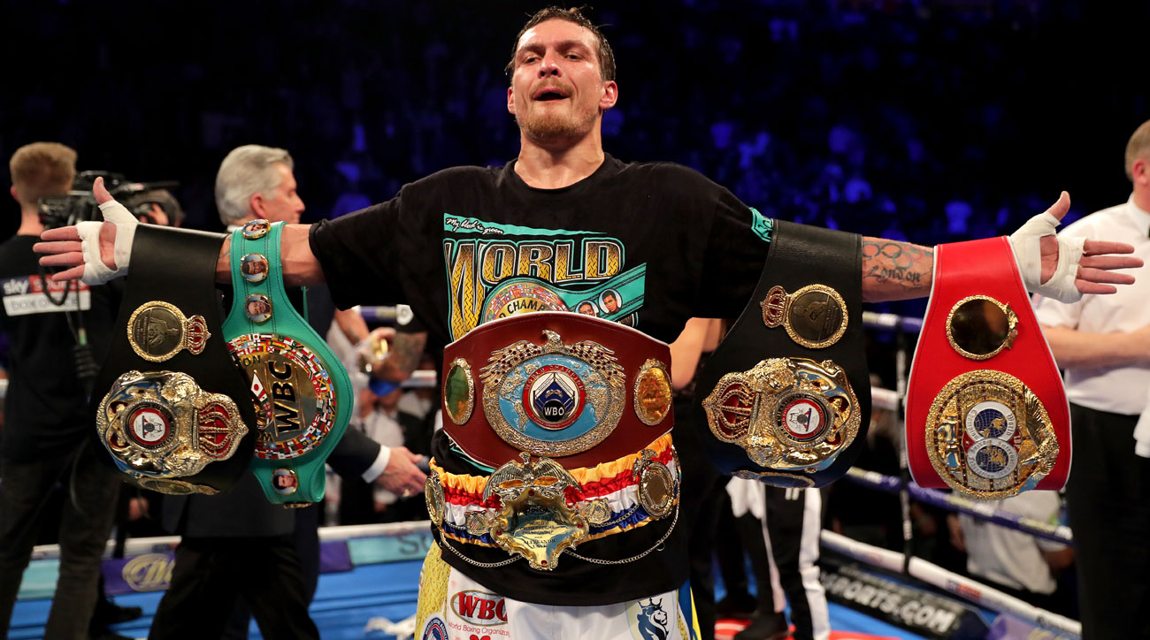 Oleksandr Usyk of Ukraine celebrates victory over Tony Bellew of England