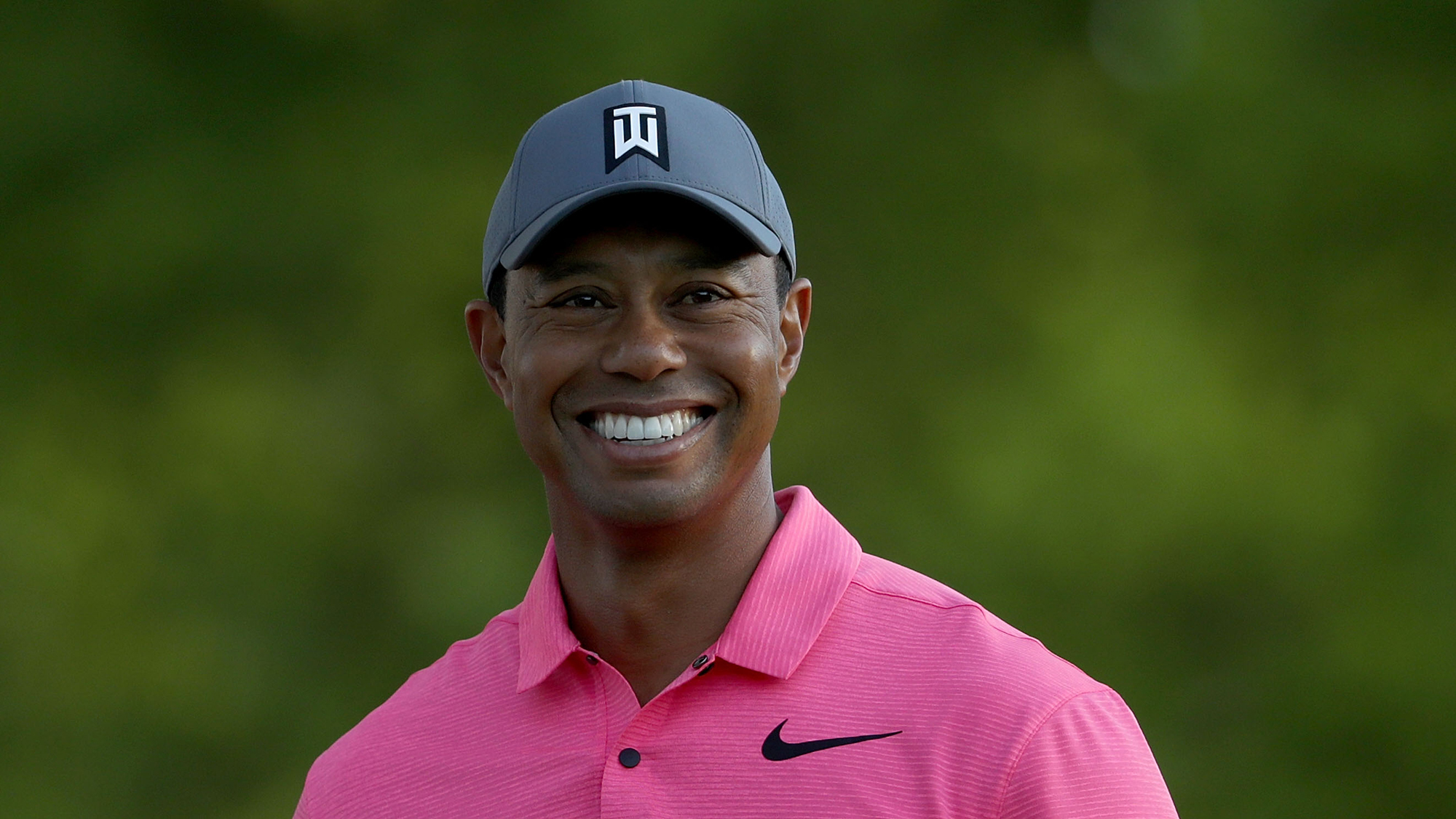 Tiger woods year two comeback smile