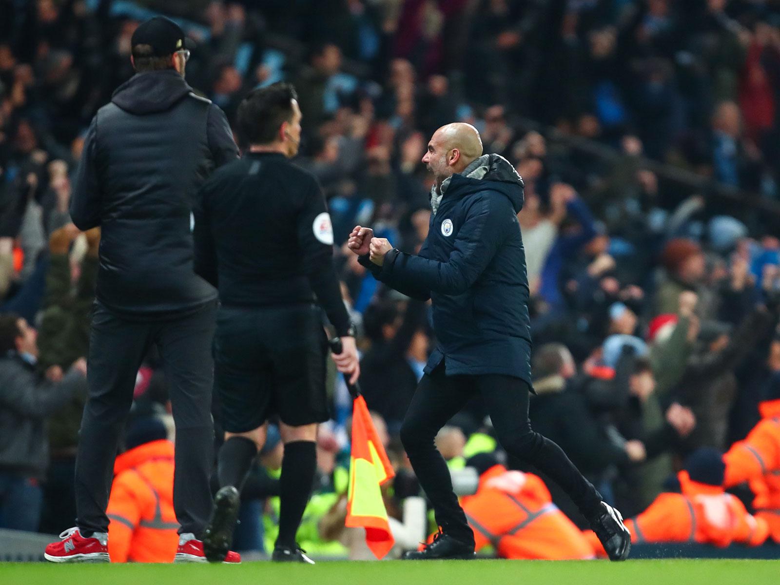 Pep Guardiola celebrates Man City's win over Liverpool