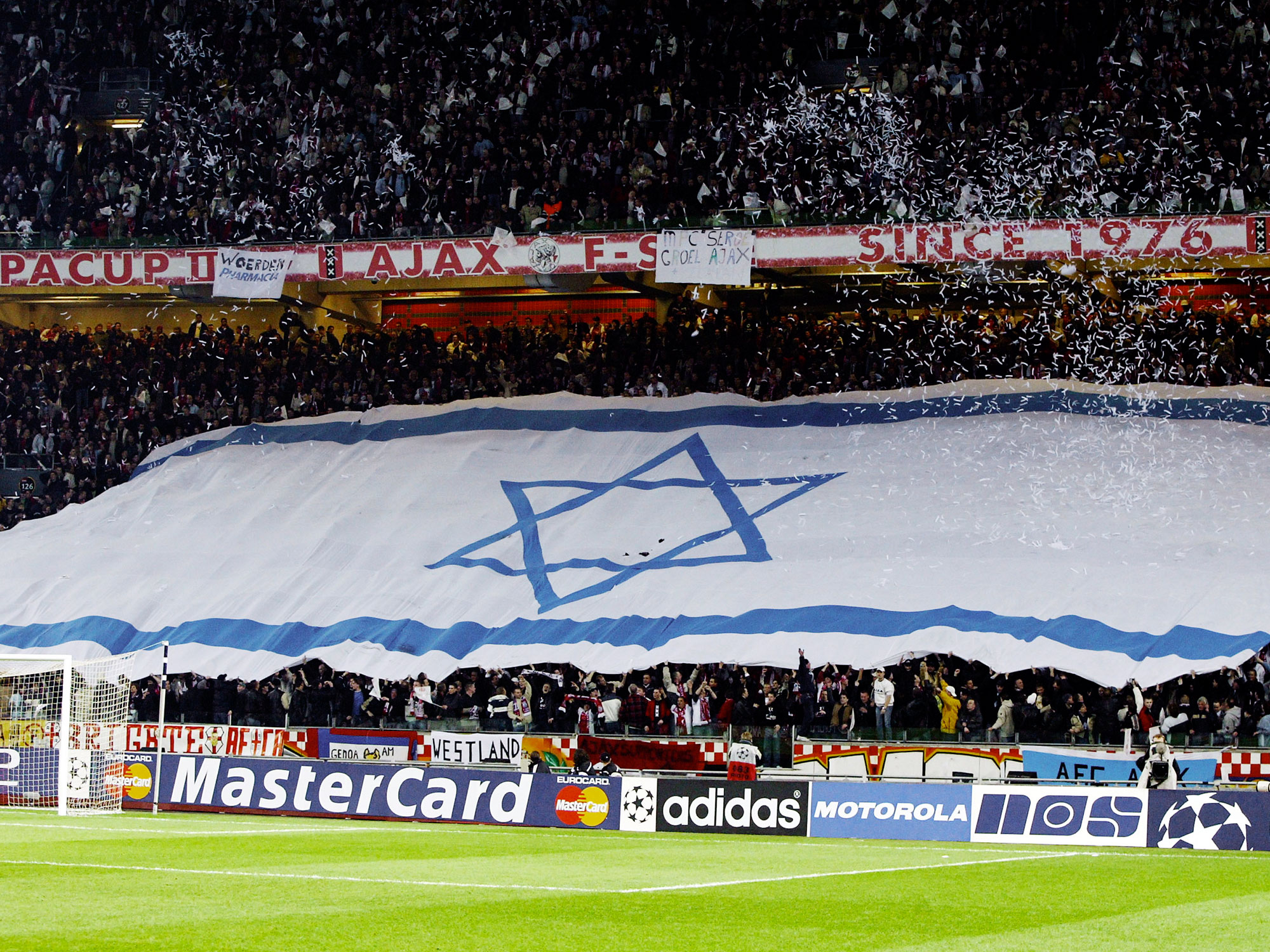 Ajax fans unfurl an Israeli flag at the Amsterdam ArenA