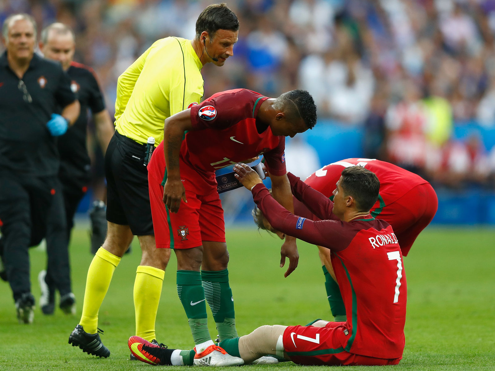 Nani takes the Portugal captain's armband from Cristiano Ronaldo in the Euro 2016 final