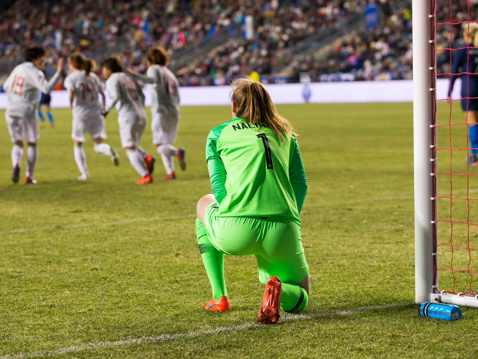 Alyssa Naeher looks on after conceding a goal to Japan