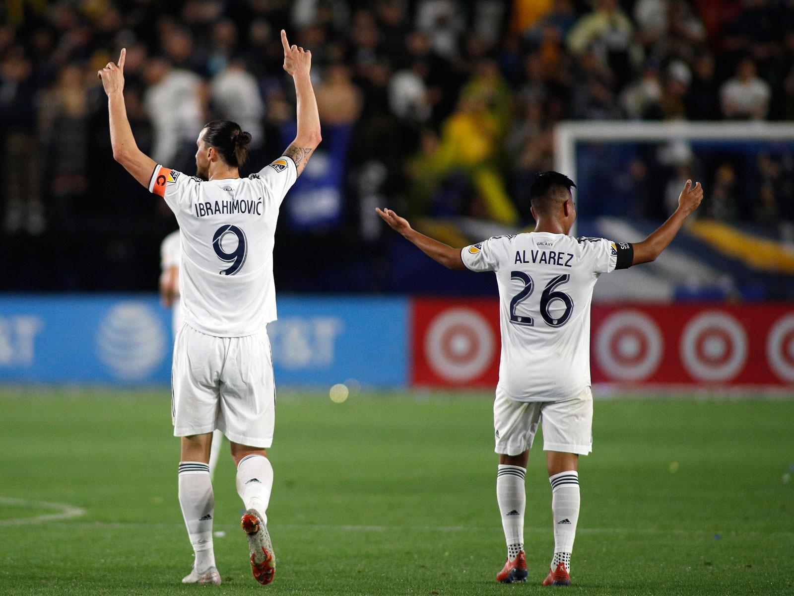 Zlatan Ibrahimovic and Efrain Alvarez celebrate the LA Galaxy's win over the Chicago Fire