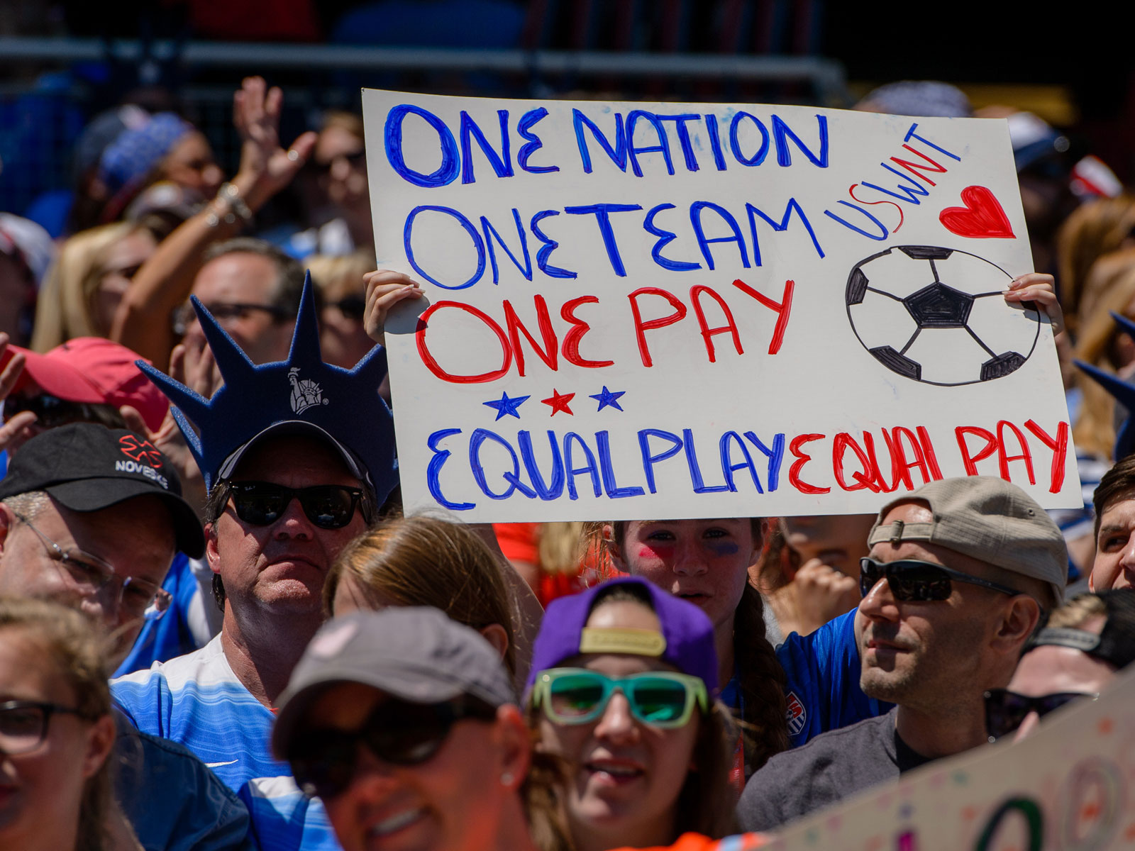 Fans in support of equal pay between the U.S. men's and women's national teams.