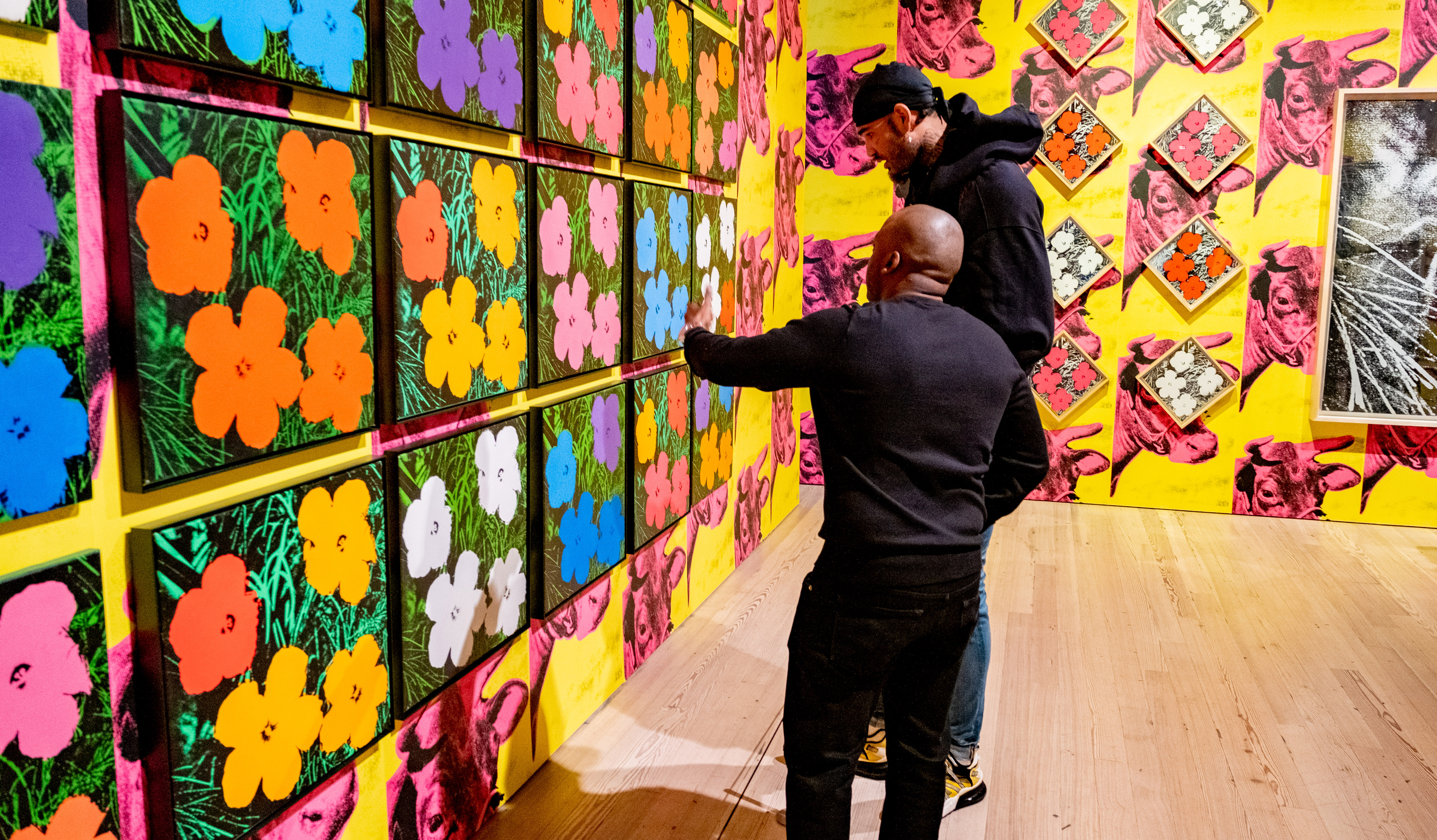 New York-based art adviser and collector Gardy St. Fleur guides Sacramento Kings center Willie Cauley-Stein through The Whitney Museum of American Art during a visit.