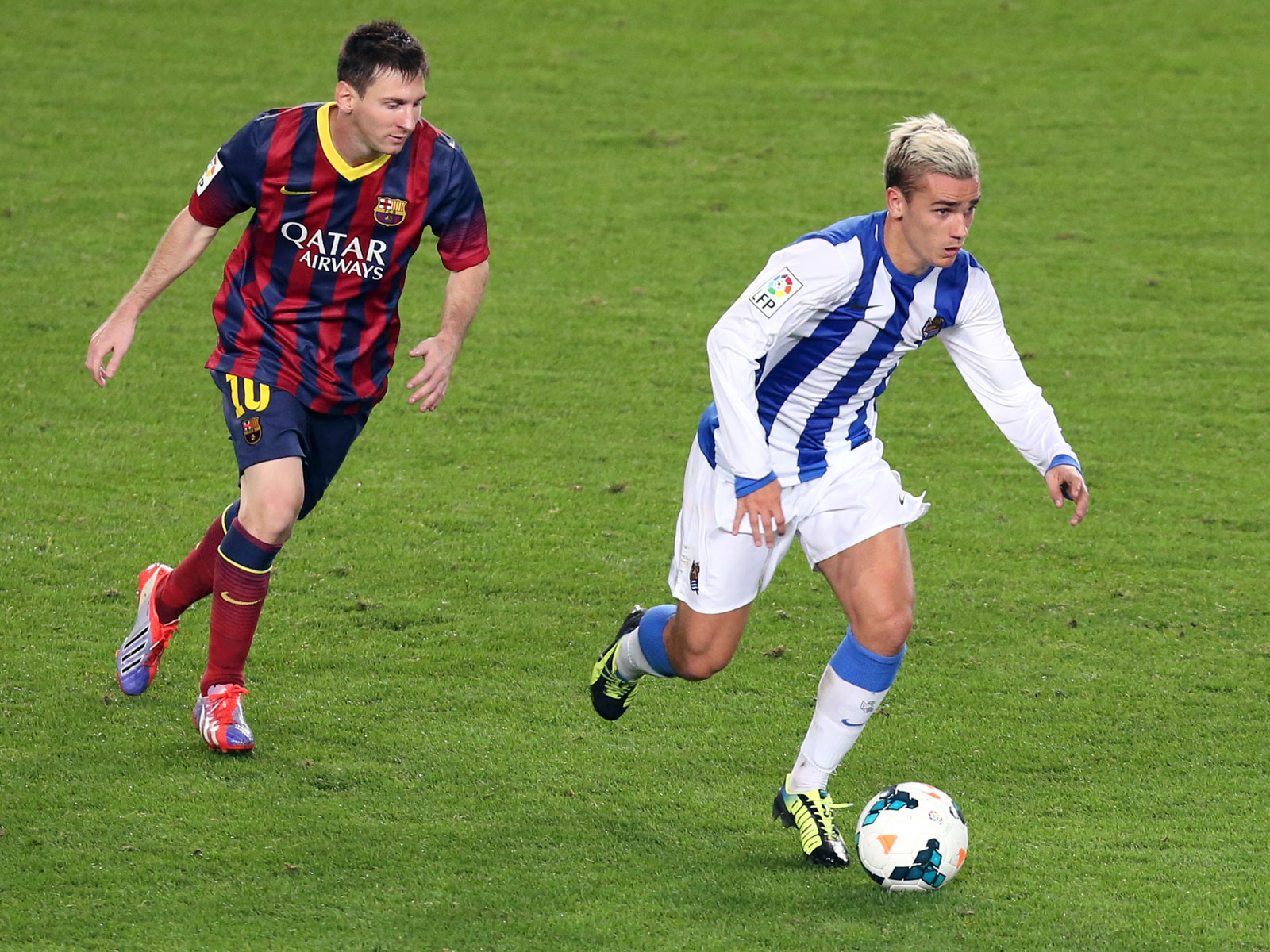 Antoine Griezmann, playing for Real Sociedad, against Lionel Messi and Barcelona