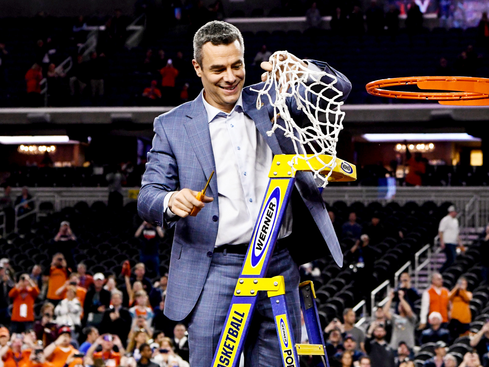 Virginia's Tony Bennett cuts down net