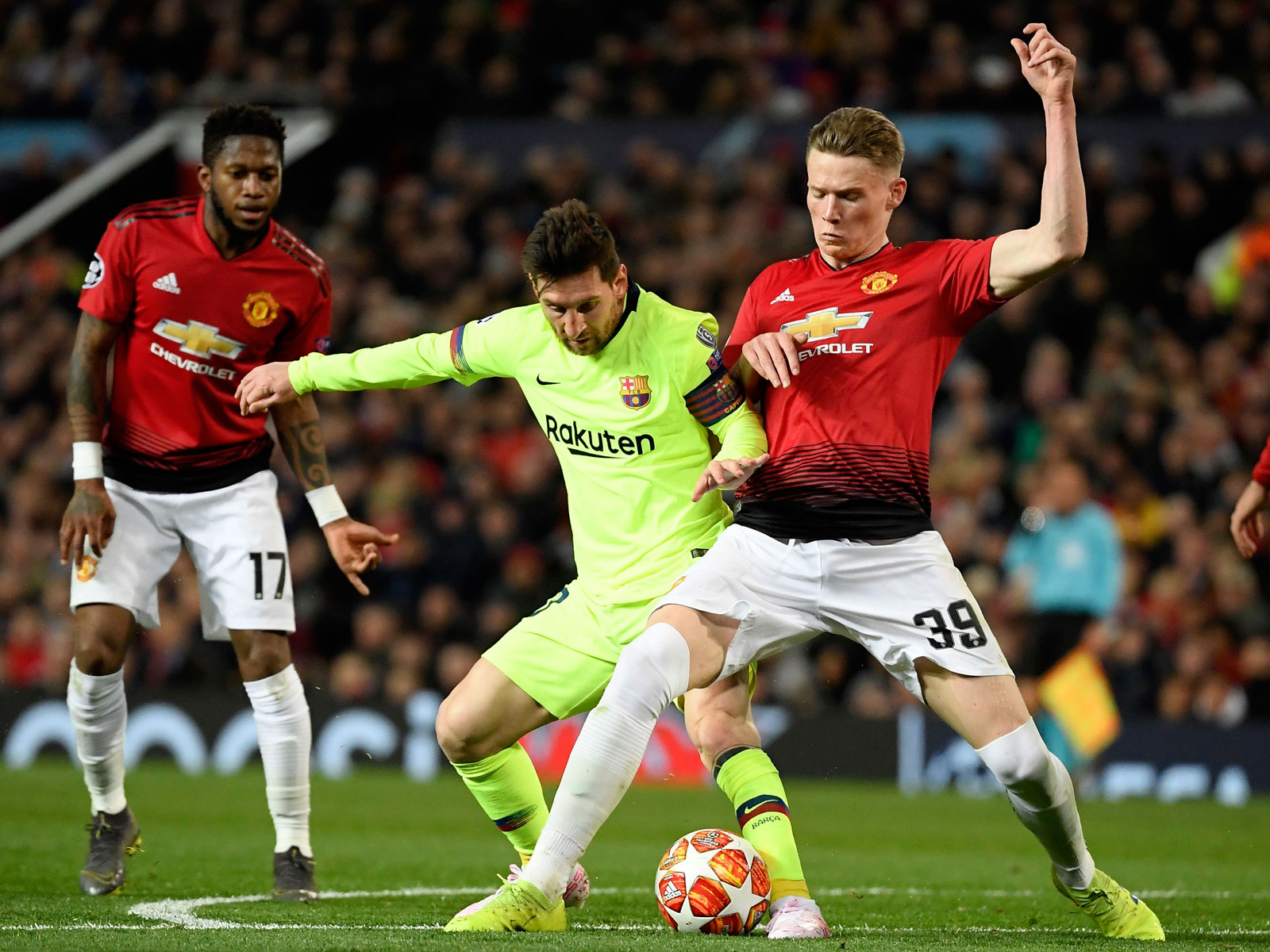 Scott McTominay defends Lionel Messi in the Champions League