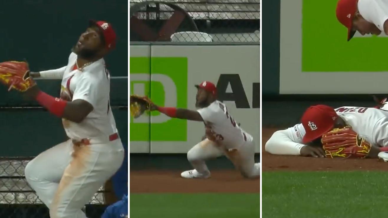 Cardinals' Marcell Ozuna climbs wall, falls (video)