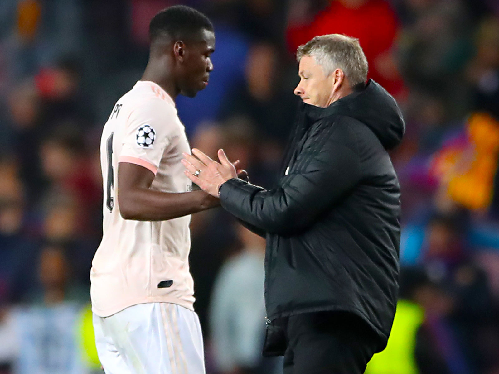 Paul Pogba and Ole Gunnar Solskjaer during Man United's loss to Barcelona