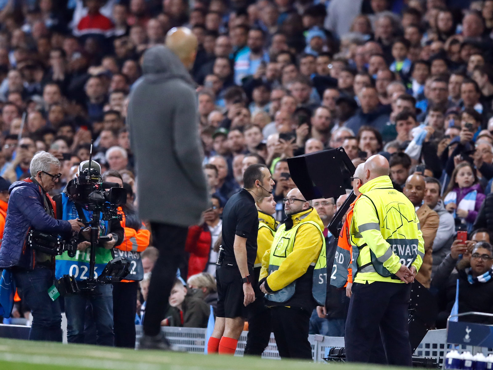 Pep Guardiola watches as the referee checks video replay
