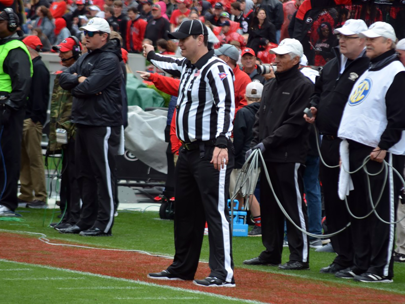 Among the numerous pre-snap responsibilities of the line judge: signaling to the other officials that the widest receiver is not on the line of scrimmage.