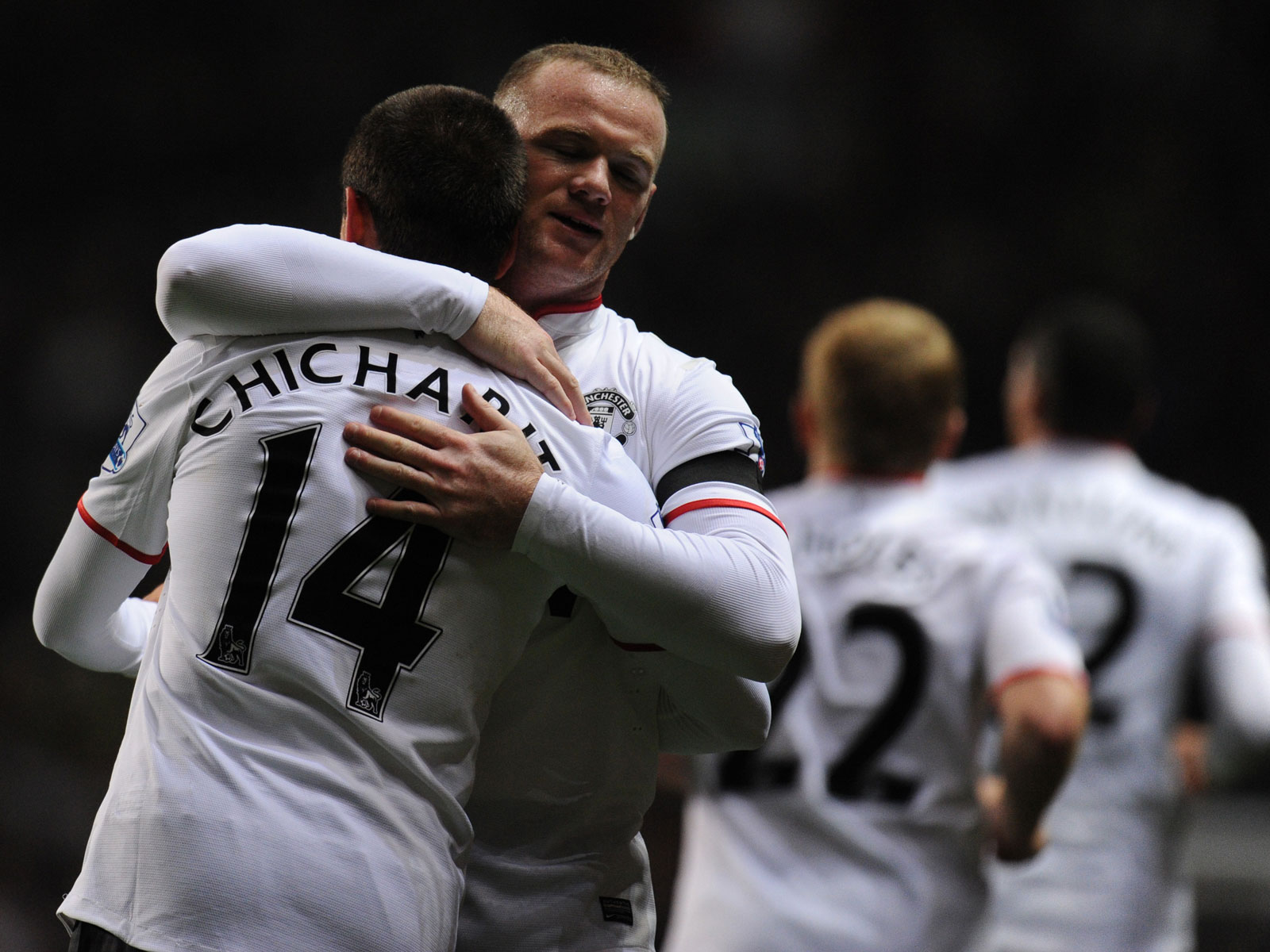 Wayne Rooney and Javier Hernandez hug while playing for Manchester United in 2012